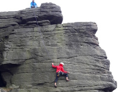 Climbing at Stanage picture