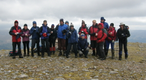 George's  friends celebrate on  Beinn Bhan